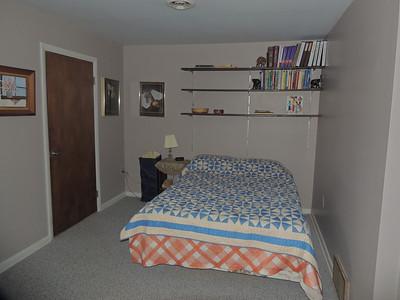 Lower level bedroom (#4).  Door on left leads to workshop.
