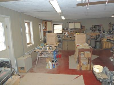 Workshop under garage with windows facing south.
