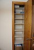 Adjustable shelves in linen closet