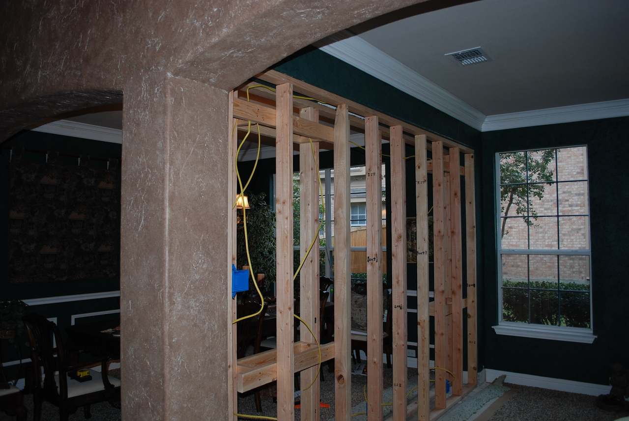 Framing commences for divider wall.  Electrical is roughed in.