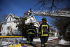 HOLLY PELCZYNSKI - BENNINGTON BANNER Firefighters extinguish a attic fire on Main St. on Friday afternoon in Bennington.