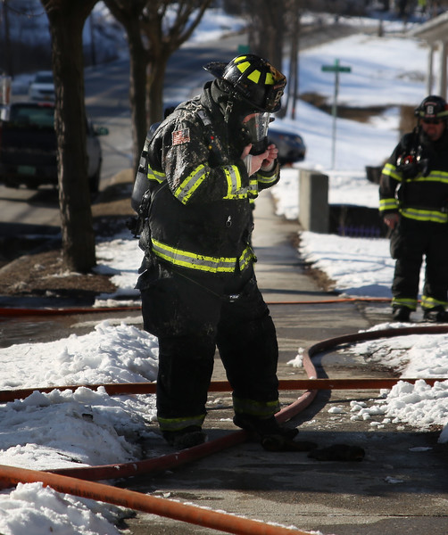 HOLLY PELCZYNSKI - BENNINGTON BANNER Firefighter, Jeff Vickers stands outside covered in instalation after combatting a fire inside an attic of a residence on Main St. in Bennington on Friday afternoon. Firefighters were able to extinguish the fire. The cause is under investigation at this time.