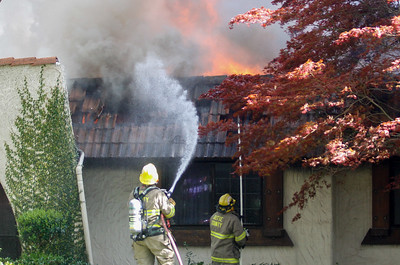 Firefighters work to put out a house fire on Fairway Drive, near Estates Drive March 23, 2017 in South Chico, California. (Emily Bertolino -- Enterprise-Record)