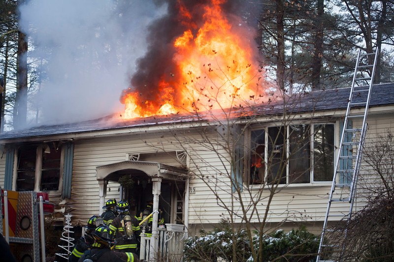 Firefighters battle a blaze at 15 Georgiana Road in Billerica Thursday morning. Lowell Sun/Chris Lisinski
