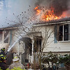 Firefighters try to put out a blaze at 15 Georgiana Road in Billerica on Thursday. Lowell Sun/Chris Lisinski