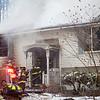 Firefighters prepare to enter 15 Georgiana Road in Billerica while battling a house fire on Thursday. Lowell Sun/Chris Lisinski