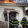 Flames were visible through a hole in the roof of the Georgiana Road home in Billerica for about an hour Thursday morning. Lowell Sun/Chris Lisinski