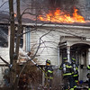 Firefighters use a hose to suppress a Thursday morning fire at 15 Georgiana Road in Billerica. Lowell Sun/Chris Lisinski