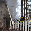 Firefighters spray the house at 15 Georgiana Road in Billerica with water while battling a large fire Thursday morning. Lowell Sun/Chris Lisinski