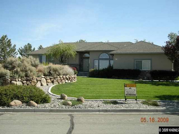 The house sits on 1/2 an acre.  A good portion of both front and back yard is landscaped with natural and drought resistant sage, rabbitbrush, etc.
