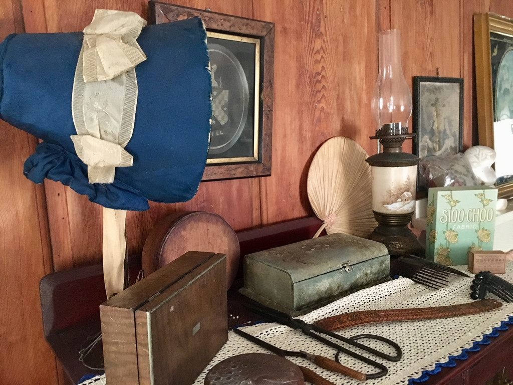 . Grooming items from earlier times covered a bureau in the bedroom of the Clara Sexton House. Photo by Mary Leach