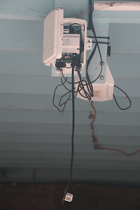 Temperature humidity sensor temporarily hanging from ISS board