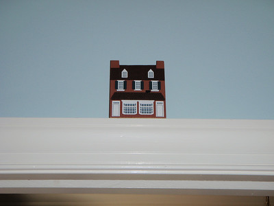 """Flat"" historic Salem buildings from Martha Gomer.  These thin wood shapes are handpainted (in meticulous detail) and placed at the top of door ledges. This is the Moravian Gift Shop in Old Salem."