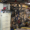 Old punch-card cabinet full of bike parts and bike storage.