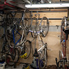 "bike storage using Rubbermaid ""FastTrak"" hooks.  Easy to reconfigure as bikes come and go."