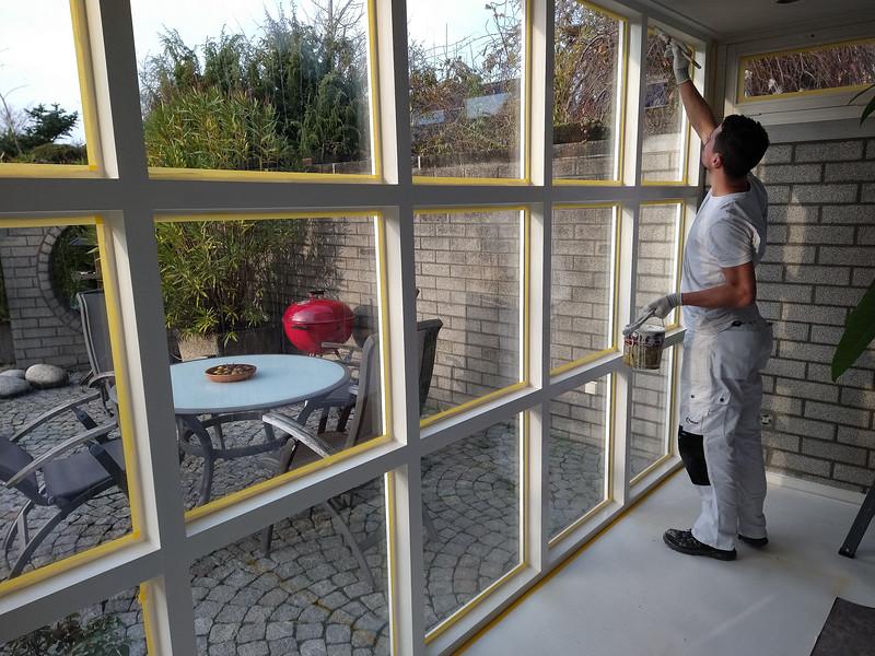 John paints the window frames