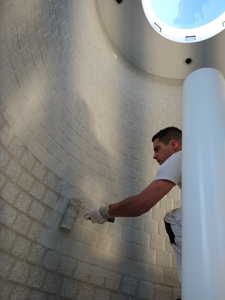 John painting the walls of the stair tower
