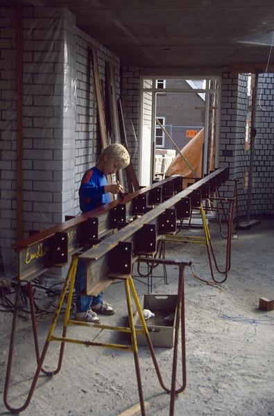 Jeroen paints the purlines (August 1989, building my house)
