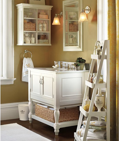 4. Create some pretty/functional vignettes. Not that the existing cabinet needed to be changed, but I popped a more clean-lined cabinet (Pottery Barn) on the wall above the toilet. I also used a couple of white-painted, wood corbels (Home Depot) and a white-painted wood dowel for towels, underneath it. ~ theletteredcottage.com