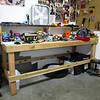 workbench is messy, area under workbench is underutilized