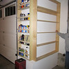 "other side of the shelving unit done.  6"" shelves aren't really deep enough. but I'm sure i'll have it full in a week anyway."