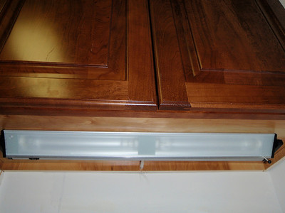 Under-cabinet light tilted forward