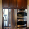 Appliances are stainless steel.  Refrigerator is Samsung.  Double ovens and warming drawer are GE profile.