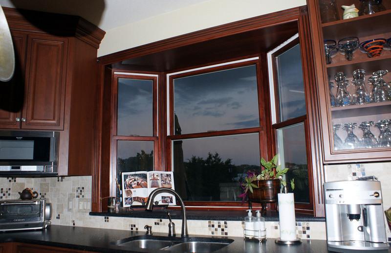 Bay window above sink.