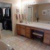 Master bath with dual vanities and garden tub and walk-in closet