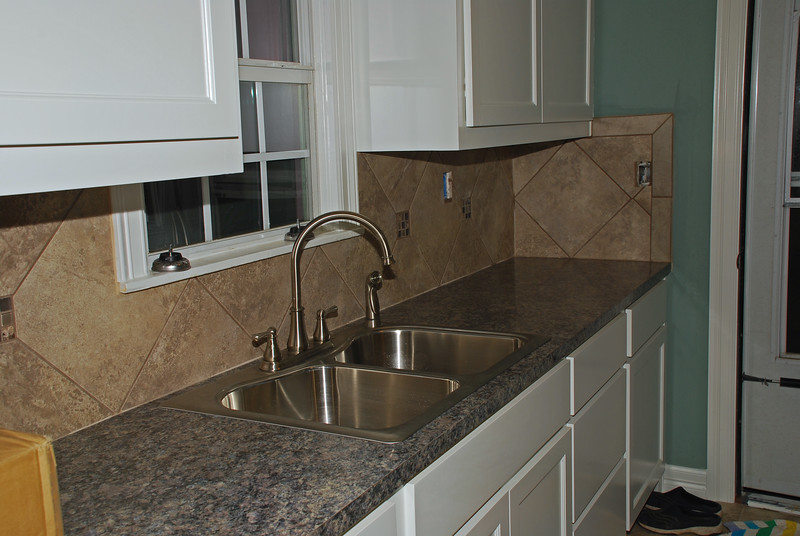 12/4/2012  Today  I got a sink.  No more washing dishes in the bathtub!  The backsplash also got grouted.