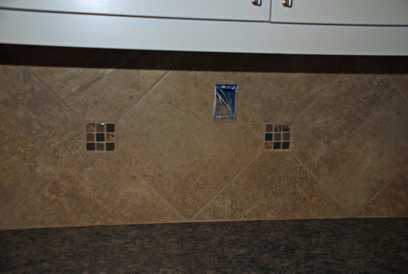 This is the backsplash with the grout finished and dry.