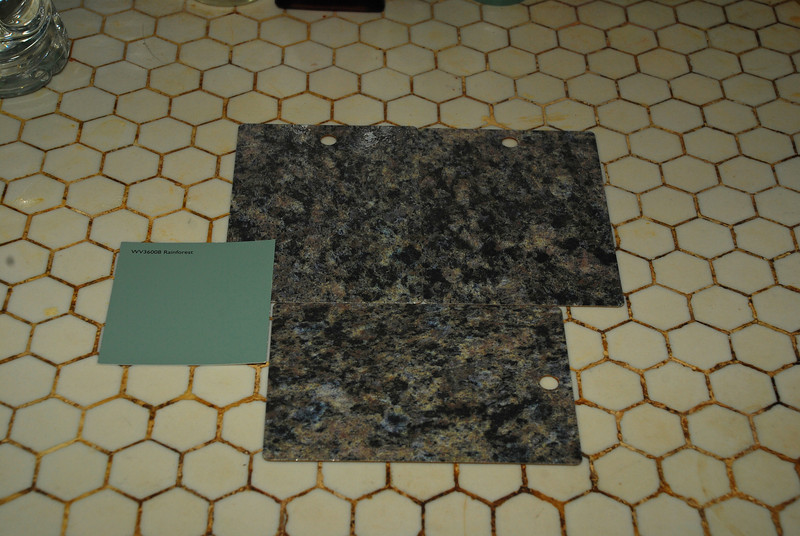 Kitchen remodel--items chosen.  This is a sample of the countertop.  The green square is the color I've chosen for the wall.
