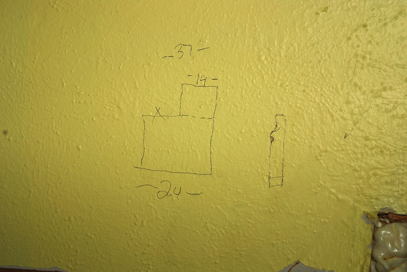 10/24/2012  I also met with the cabinet guy today.  He did his final measurements and we talked about a couple changes.  This was his drawing on the wall to give me a visual of what we were talking about.  Now he does drawings to show exactly what things will look like before he actually starts building them.