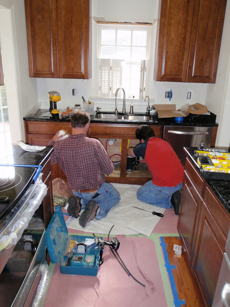 Chris and Chad work on the plumbing