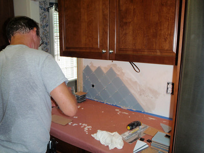 Chris starts the installation of the backsplash with spacers