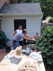 Chris and Chad at work on the patio with the glass tile cutter