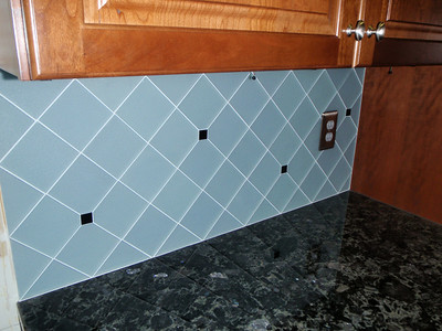 08/04 - Grouting done and new switchplates installed.