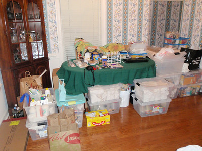Contents of kitchen packed up and stored in dining room