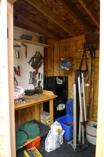 The shed contains garden/shed-like things.  No bikes!