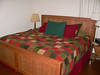 """Our new handcrafted cherry bed in the """"white room,"""" our room for the duration."""