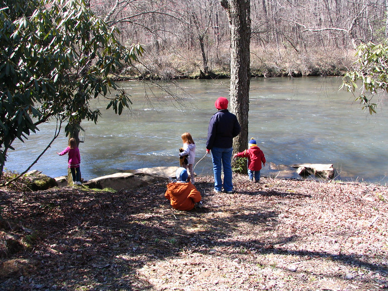 Playing by the Toccoa River.  The trails go right along the river.