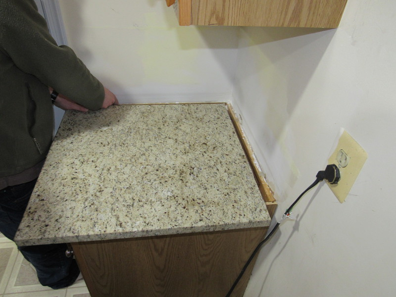 My brother lifting out one of the other small countertops that was not bonded in place