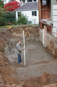 After digging up the oil tank, the excavators dug for the new foundations in the back and on the north side.
