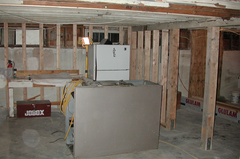 Our old furnace, sitting in the basement waiting to be hauled away. New posts and framing, too.