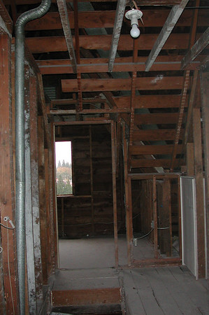 Looking toward the front of the house. The demolition crew left all the framing and electrical in place.