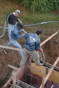 More concrete for the foundation. That hose gets really heavy.