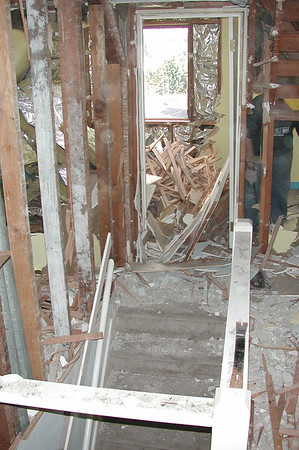 By midday on the first day, our second floor was toast. All of the plaster and lath had been removed and was heaped on the floor.