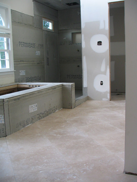 The tile was installed on the floor first.