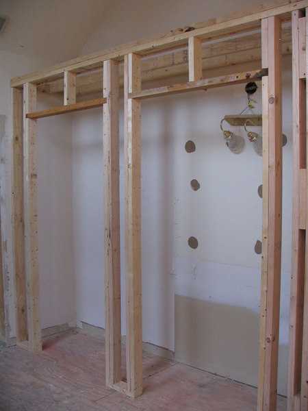 They built reach-in closets which will have 2 sets of double doors.  These are where the dressing table used to be.  Our master bedroom walk-in closet is not very large, so we thought this would be a great way to add more closet space.