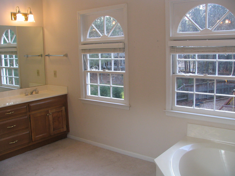 A before picture of part of our vanity and garden tub.